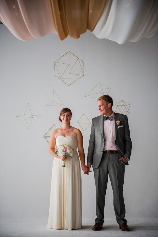 a painted geometric wedding backdrop   just paint whatever you like on the wall and enjoy