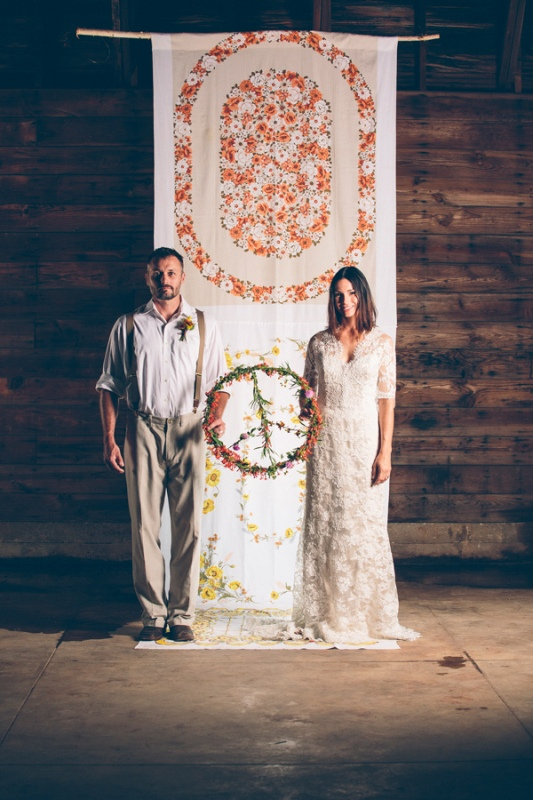 a curtain with painted blooms is a cool idea for a free spirited indoor wedding, you can also embroider them if you want