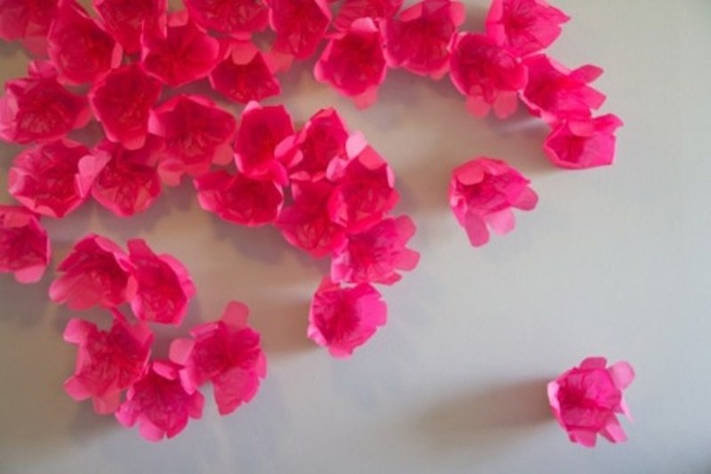 a bright paper floral backdrop   just make some paper flowers and attach them to the wall and voila