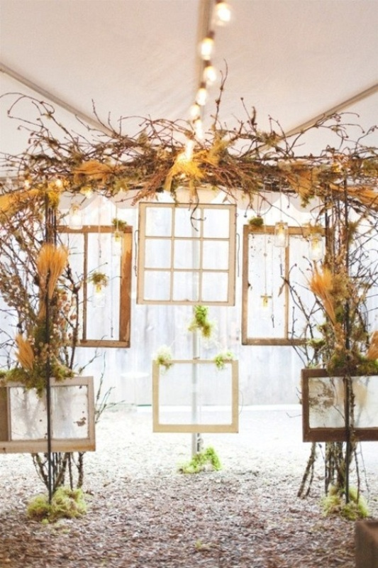 a cool wedding backdrop of vintage frames, window frames, dried blooms and herbs and vines