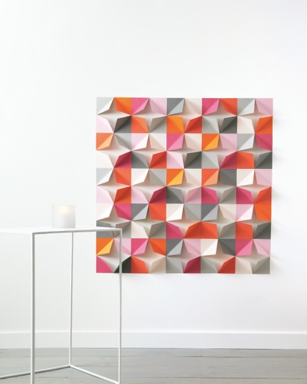 a bright paper geometric backdrop with lots of colors to fit a colorful wedding with a modern twist