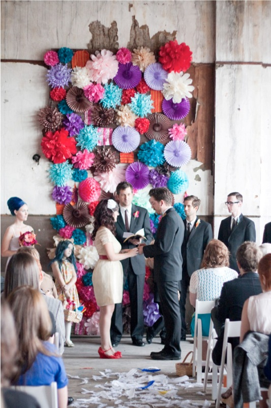 a colorful paper fan wedding backdrop is a very cheerful and fun idea for the couples who love whimsy decor