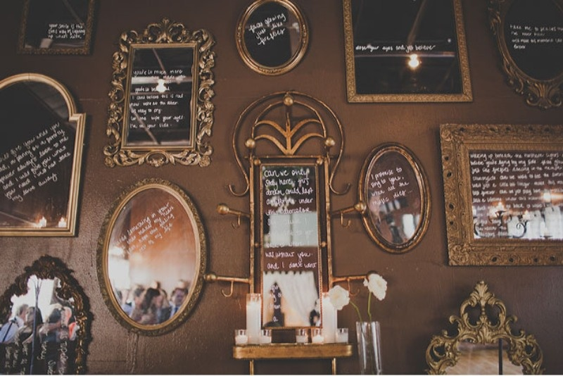 a beautiful wedding backdrop made of lots of vintage mirrors with wishes is a unique idea that will make your ceremony more special
