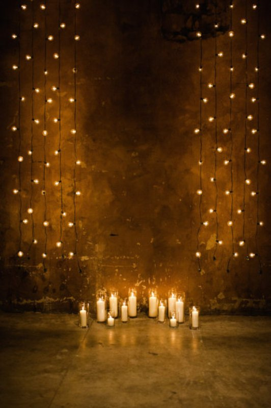 lights hanging down plus some candles on the floor will soften any venue, even the most industrial and rough one