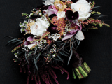 a neutral and pink wedding bouquet spruced up with dark callas and purple touches