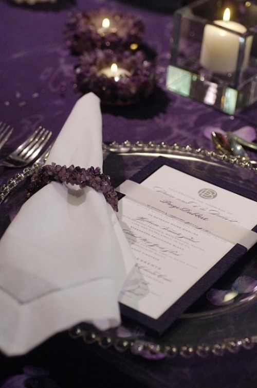 a purple tablecloth, amethyst candle holders and napkin rings look chic and bold, geodes are very trendy