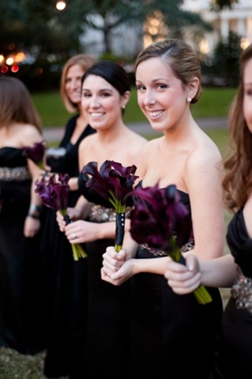 deep purple calla bouquets may be offered to bridesmaids for an elegant feel