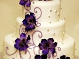 a patterned wedding cake decorated with purple flowers