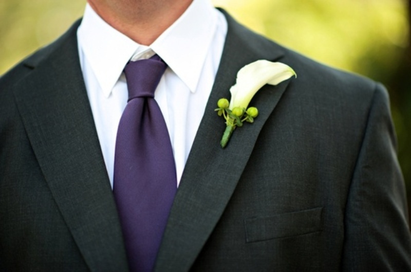 a black suit, a white shirt and a purple tie for a bold and chic look