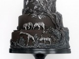 a black wedding cake with dimensional patterns and animals from Africa is a very safari-like idea