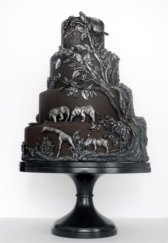 a black wedding cake with dimensional patterns and animals from Africa is a very safari like idea
