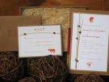 a bright safari themed wedding invitation suite with orange prints showing African animals