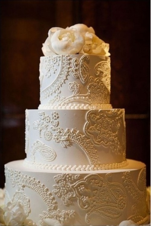 a white lace wedding cake topped with fresh white blooms on top is an elegant and stylish piece with a romantic touch