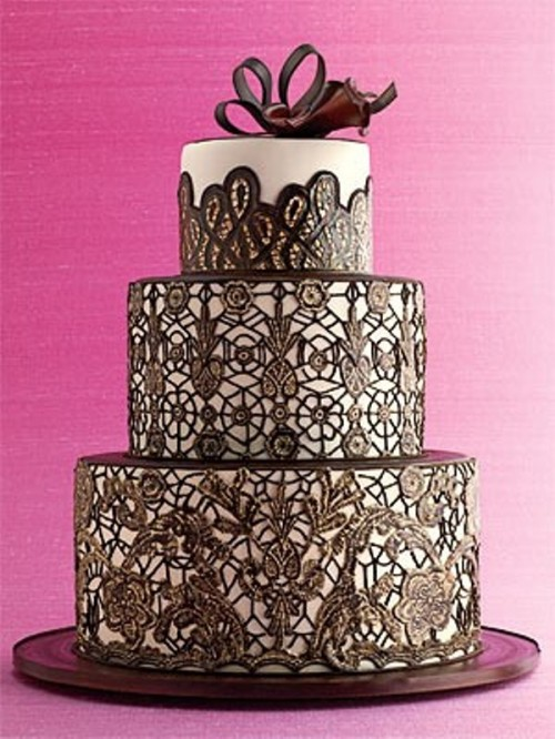 a black and white lace wedding cake with a chocolate bow on top is a very chic idea with a refined feel