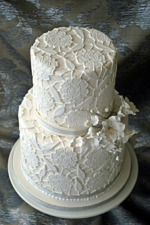 a neutral lace floral wedding cake with ribbons and sugar flowers is a beautiful and elegant idea