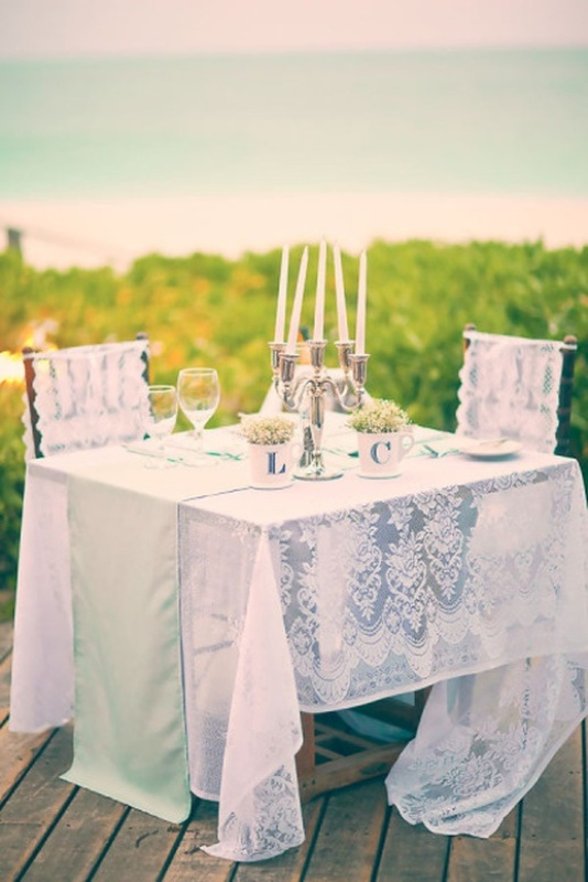 accent your sweetheart table with a table runner, a candelabra and some greenery in mugs with your monograms