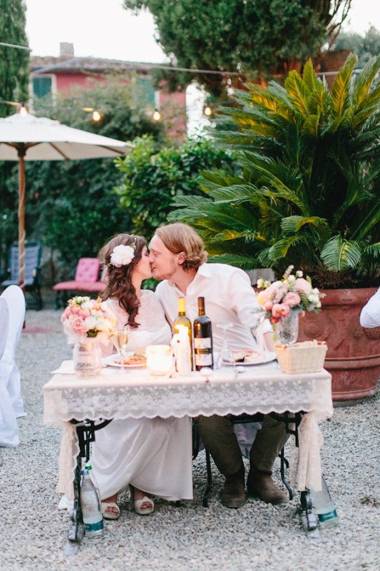 a cute white lace tablecloth and lush florals on the table plus candles will hint that it's a sweetheart one