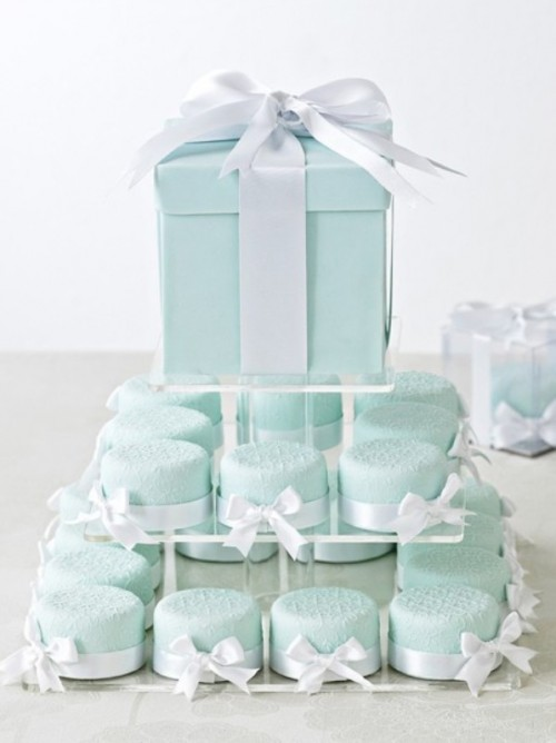 a mint box with a cake inside and mini mint-colored cakies that match a mint-colored bridal shower or wedding