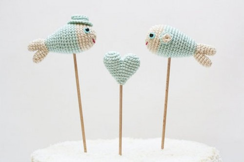 knit mint-colored fish and heart cake toppers are very whimsy and super cute