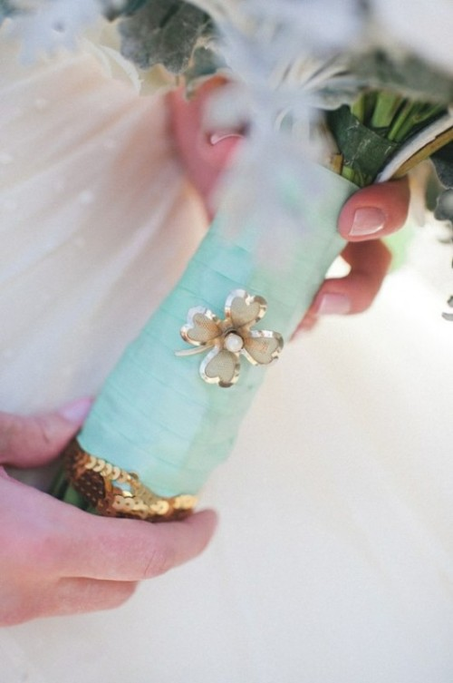 a mint ribbon bouquet wrap and a floral brooch to highlight the wedding bouquet decor
