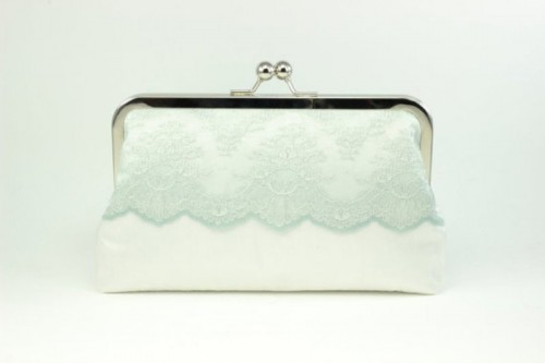 a white and mint vintage-inspired wedding clutch with lace is a chic and romantic accessory for a bride