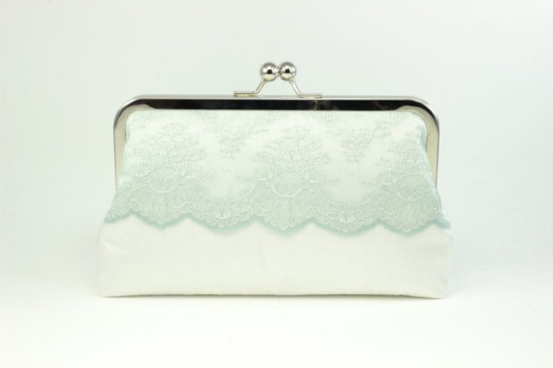 a white and mint vintage inspired wedding clutch with lace is a chic and romantic accessory for a bride