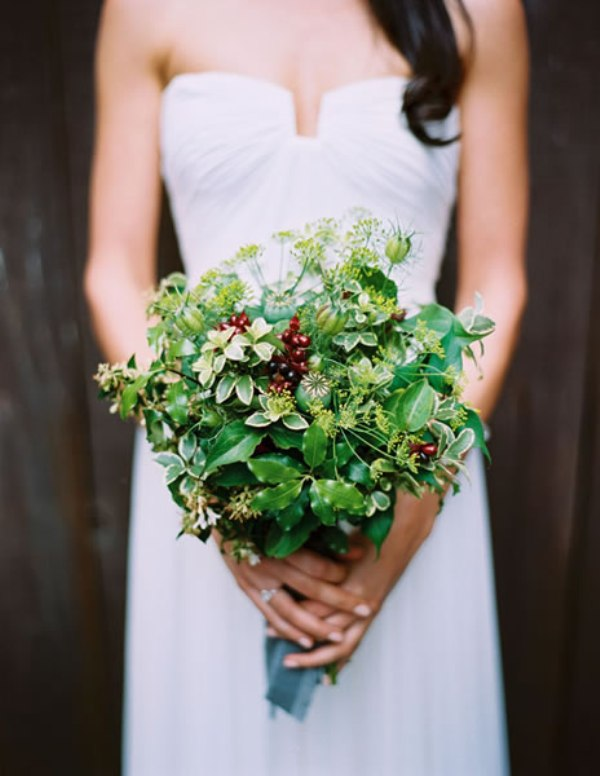 a simple emerald greenery bouquet with berries and wildflowers for a bride