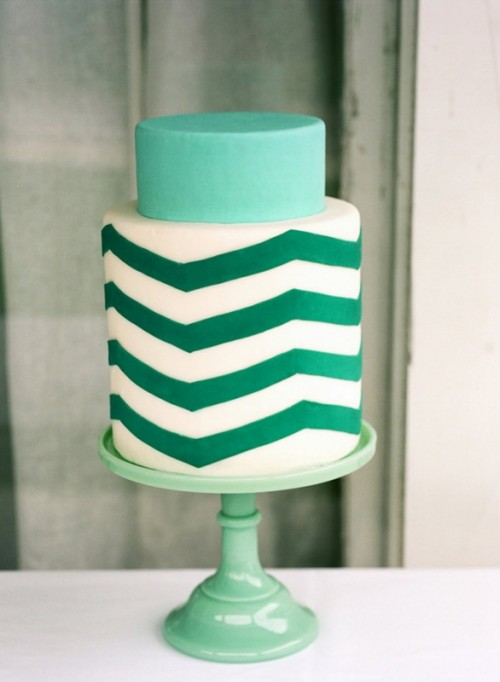 a mint and emerald and white chevron wedding cake on a mint stand for a modern wedding