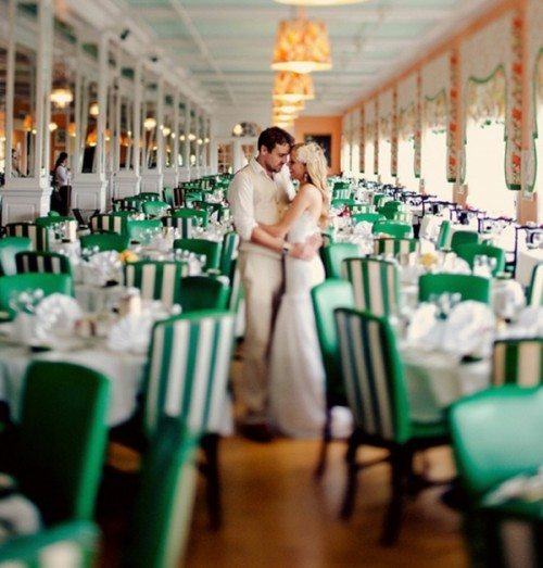 striped emerald and white chairs will make your reception bolder and cooler