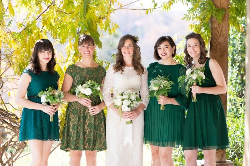 mismatching emerald and printed bridesmaid dresses over the knee for a fall wedding