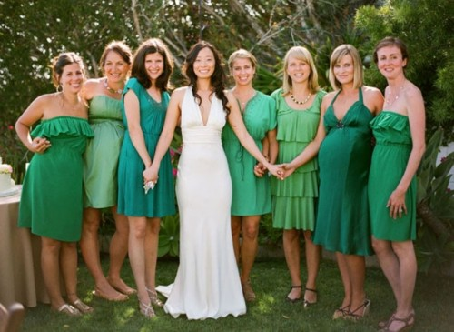 bridesmaid dresses in various shades of green including emerald will show how to pull of mismatching dresses trend