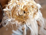 white blooms all covered with vintage brooches, watches and feathers for an art deco bride