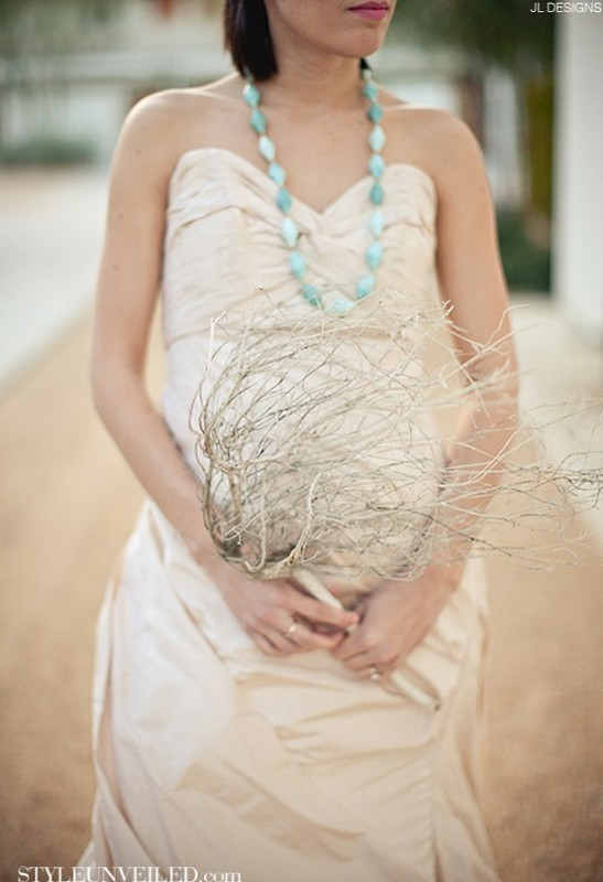 a whitewashed coral branch is a cool idea for a coastal or beach bride