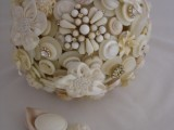 a neutral wedding bouquet of neutral-colored buttons and brooches is a chic idea for a vintage bride