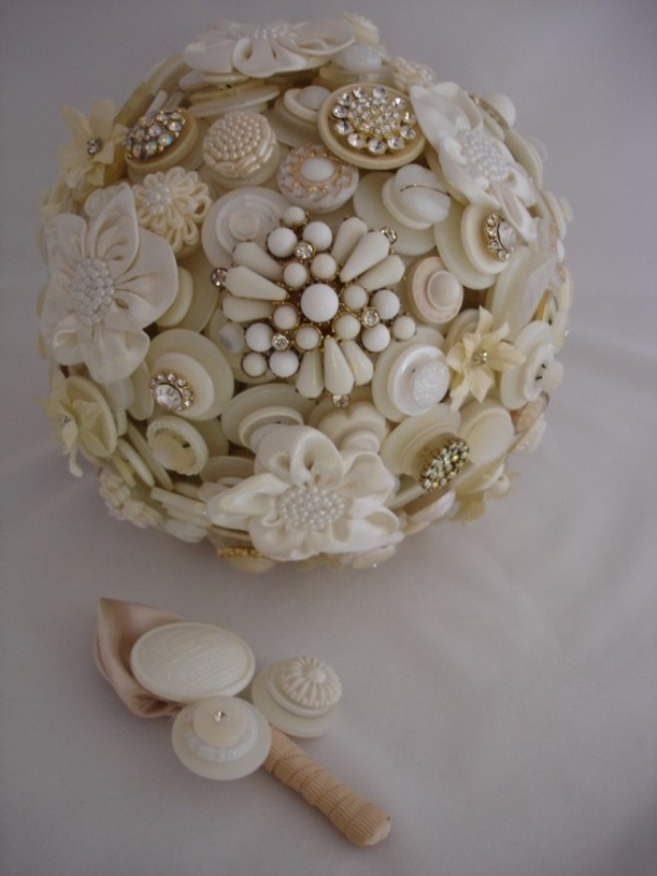 a neutral wedding bouquet of neutral colored buttons and brooches is a chic idea for a vintage bride