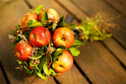 an apple and greenery wedding bouquet is a fun idea for a fall bride