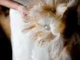 a feather and brooch wedding bouquet is ideal for a vintage bride with a touch of sophistication