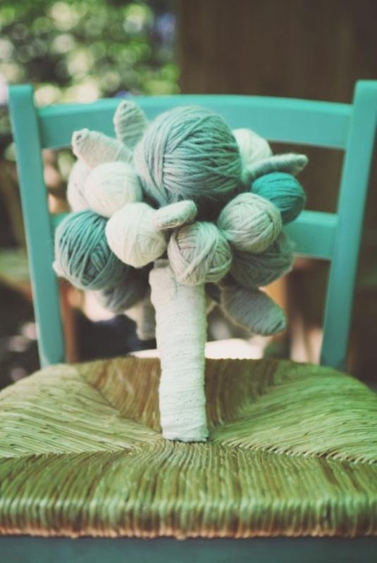 a colorful yarn ball wedding bouquet is a fun idea for a rustic or backyard wedding