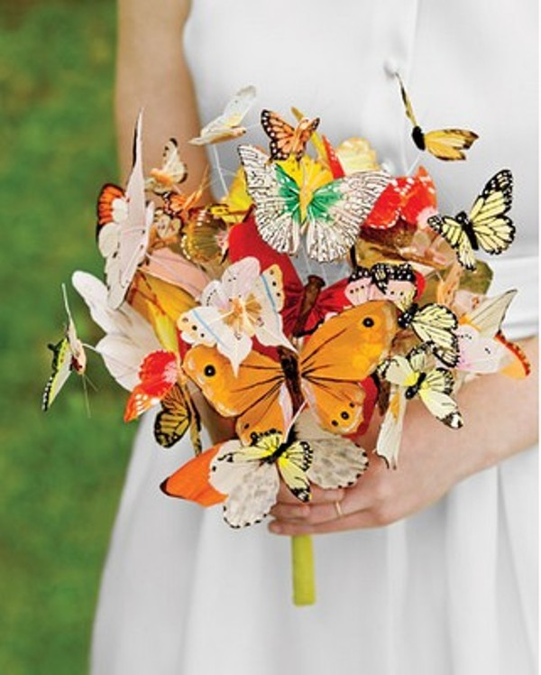 a colorful paper butterfly wedding bouquet is a dreamy and beautiful touch for a fairy tale wedding