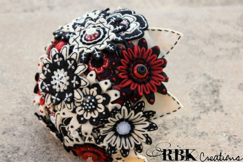 a black, red and white fabric wedding bouquet with buttons and brooches is a bold and fun idea
