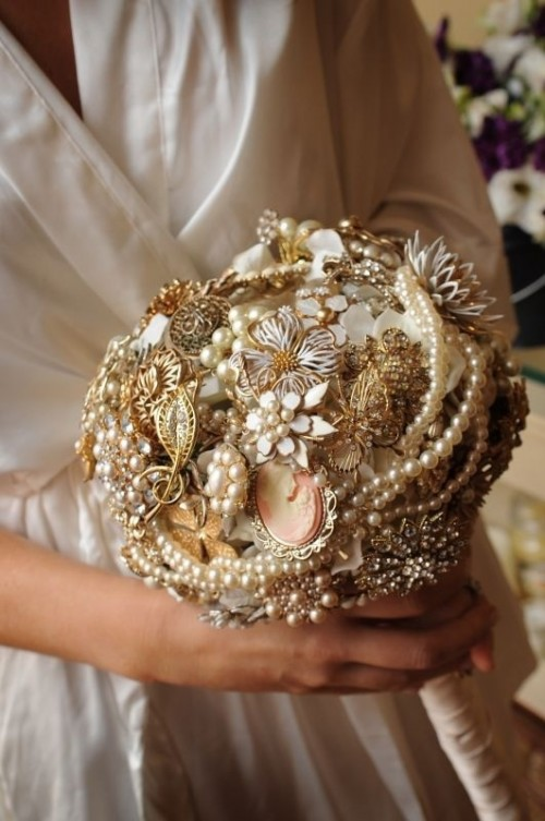 a sophisticated gold and white brooch wedding bouquet with pearls, beads and embellished flowers