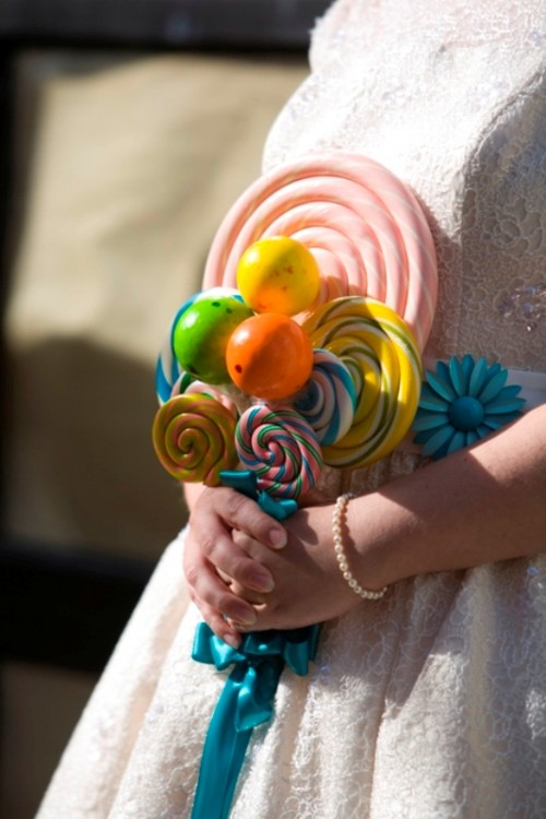 a whimsy and colorful lollipop wedding bouquet with some candies attached is a bright and fun idea