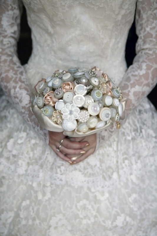 a button wedding bouquet with silk ribbons is a very cool and eco friendly idea, don't use real blooms at all