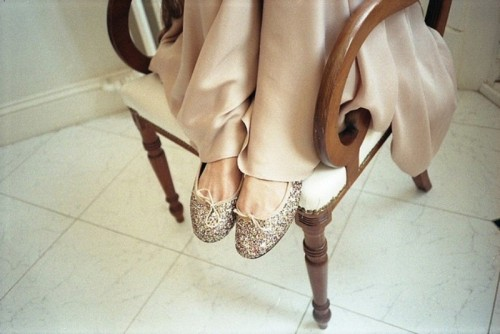 silver glitter flats with little bows are a very cute and girlish idea for a modern glam bride