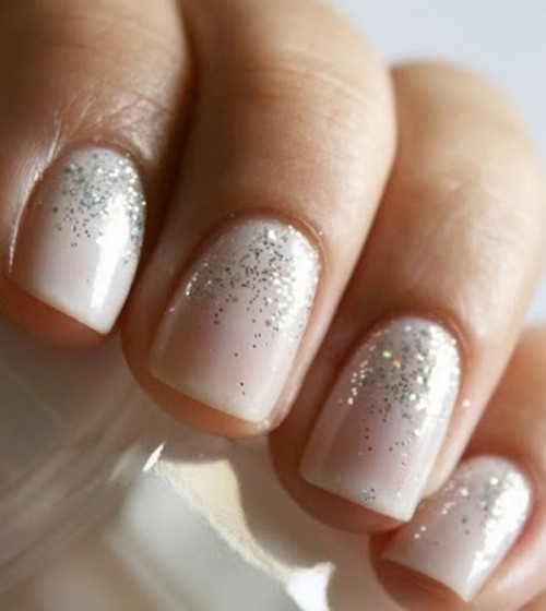 nude nails with silver glitter will be a great idea for a winter, holiday or just glam wedding
