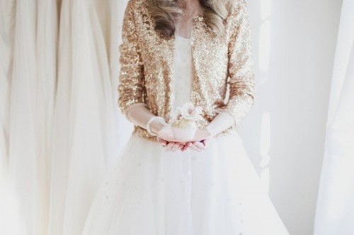 a gold glitter coverup is a lovely idea to add a bit of glam to the bridal look and is very actual for a holiday wedding