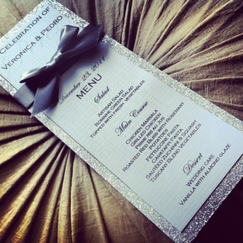 a chic silver glitter frame menu with a grey bow is a very refined and elegant idea for a glam wedding