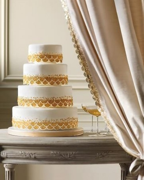 a white and gold glitter wedding cake with patterns is a glam and lovely idea for a modern glam wedding or a vintage one