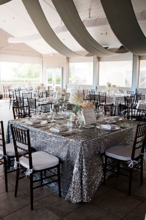 silver glitter tablecloths are ideal to add a slight shiny glam touch to your reception and make it look cooler