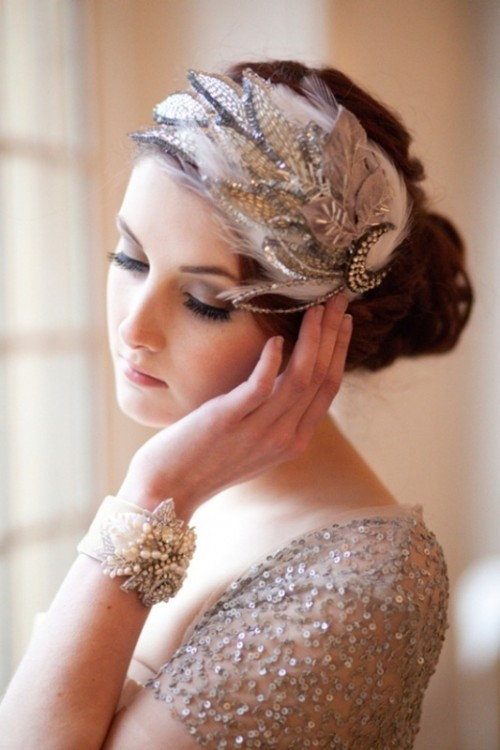 silver sequin sleeves and an embellished feather headpiece with a brooch are amazing for a glam vintage bride